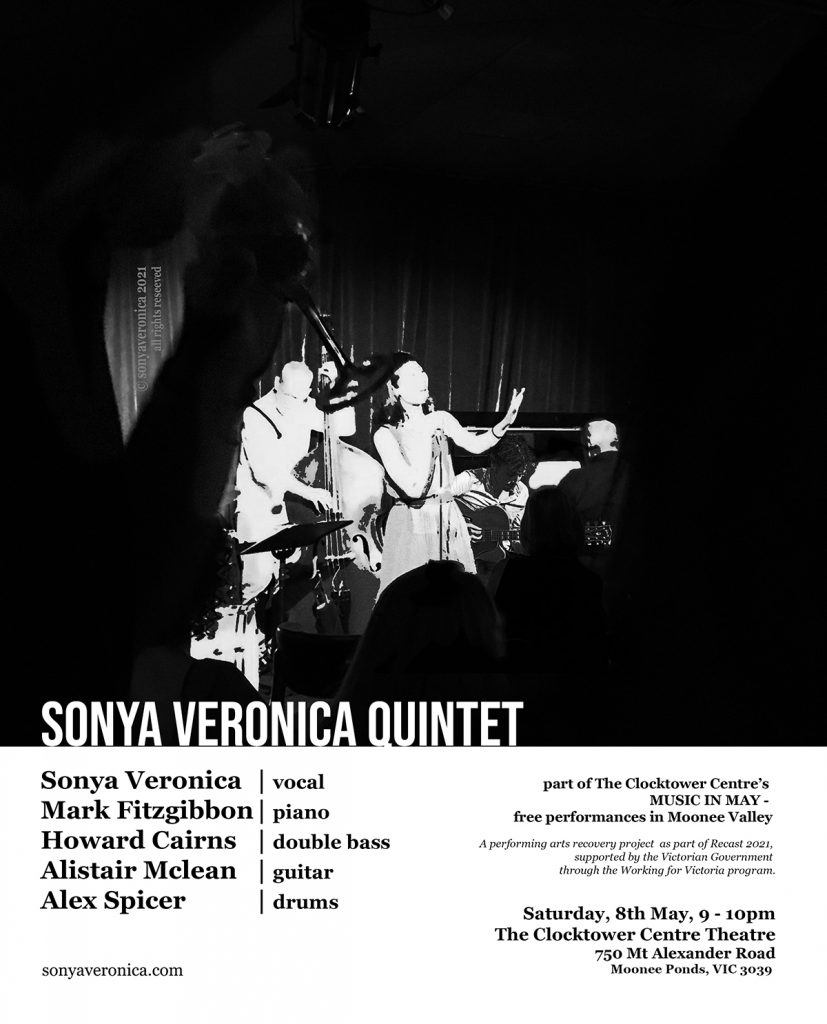 A vocalist, double bassist, pianist and a guitarist on stage, in the middle of a performance. An intimate performance with audience.